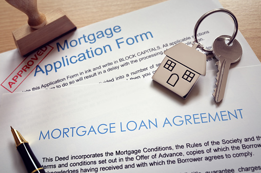 Mortgage application loan agreement and house key 817348768