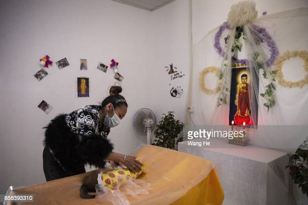 A mortician pay's respect to the remains of dog Xiaoxiao who died at the age of 6 months on March 27 2017 in Wuhan Hubei province ChinaWangzai Pet...