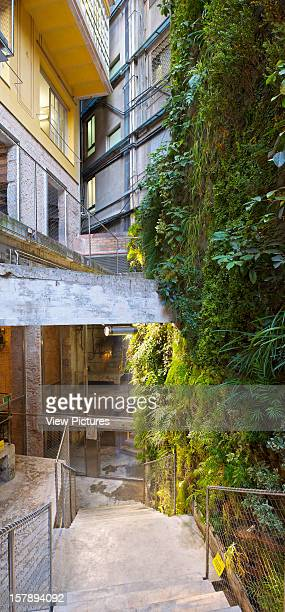Mortiz Brewery Factory In Barcelona By Atelirs Jean Nouvel Exterior Evening View Of Rear Patio And Vertical Garden By Patrick Blanc Jean Nouvel Spain...