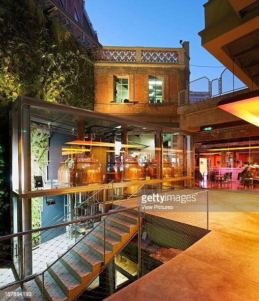 Mortiz Brewery Factory In Barcelona By Atelirs Jean Nouvel Exterior Evening View Of Rear Patio Distillery Tanks And Vertical Garden By Patrick Blanc...