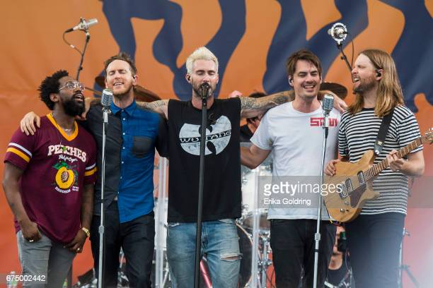 PJ Morton Jesse Carmichael Adam Levine Matt Flynn and James Valentine of Maroon 5 perform during the 2017 New Orleans Jazz Heritage Festival at Fair...