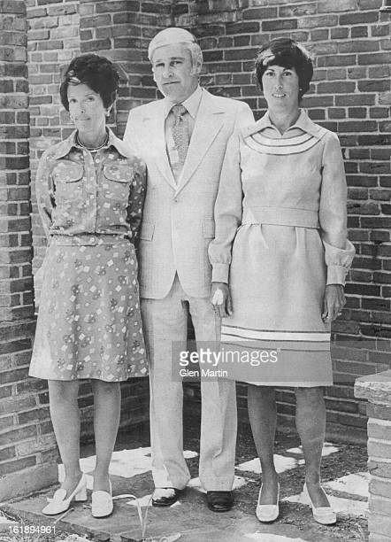 Morton Miller, president of the hospital, is flanked by Mrs. Gary Antonoff, left, the outgoing president of the women's division, and Mrs. Sheldon...