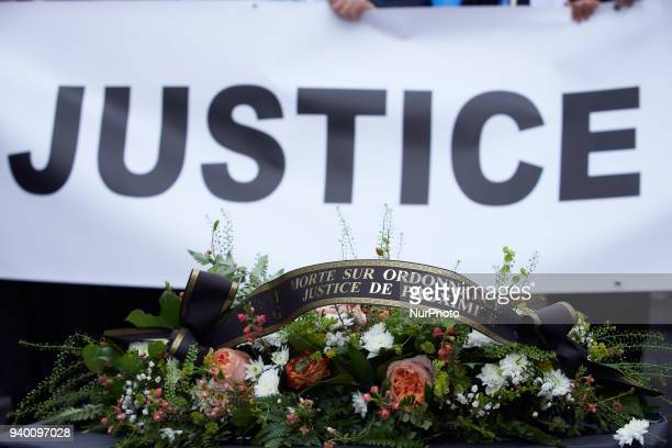 A mortuary wreath reading 'Dead on prescription proximity justice' The French Bar Association all lawyers' unions all magistrates' unions called all...