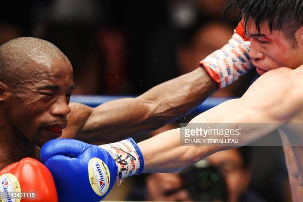 Moruti Mthalane of South Africa fights against Masayuki Kuroda of Japan during their IBF flyweight title boxing bout in Tokyo on May 13, 2019.