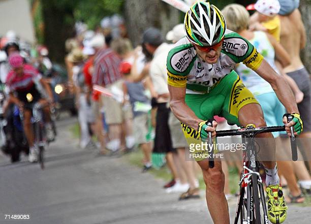 S Floyd Landis breaks away from Germany's Patrick Sinkewitch during the 200.5 km seventeenth stage of the 93rd Tour de France cycling race from...