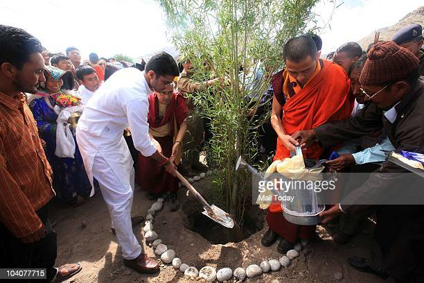 MoS for Communication and IT Sachin Pilot and Kyabje Thuksey Rinpoche planting a tree during the 'Planting on the World's Rooftop' campaign held in...