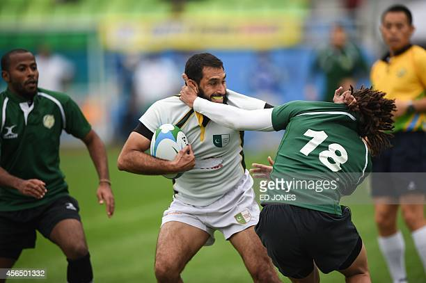 Mosab Abdullah Barnawi of Saudi Arabia tackles Umer Islam of Pakistan during their men's classification for 11th12th place rugby match event of the...