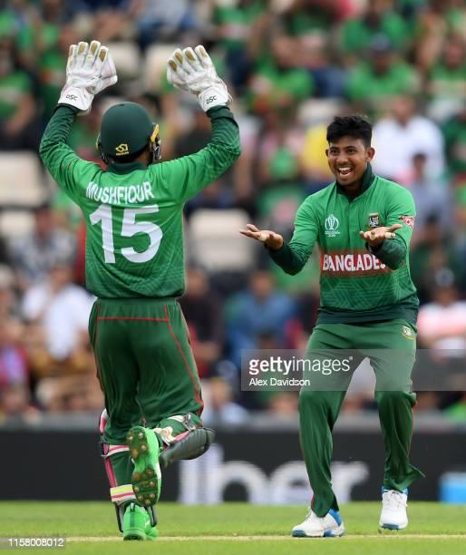 Mosaddek Hossain of Bangladesh celebrates taking the wicket of Hashmatullah Shahidi of Afghanistan with Mushfiqur Rahim of Bangladesh during the...