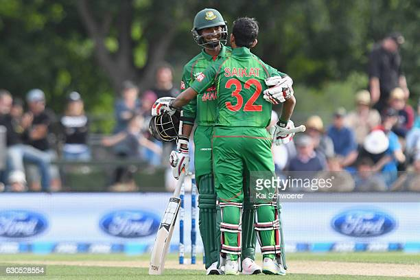 Mosaddek Hossain of Bangladesh is congratulated by Mustafizur Rahman of Bangladesh after scoring his half century during the first One Day...