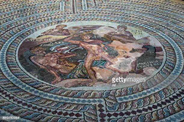 mosaic depicting theseus killing the minotaur at the theseus house in kato paphos, paphos, cyprus - republic of cyprus stock pictures, royalty-free photos & images