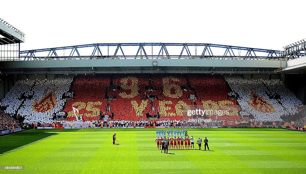 A mosaic is displayed by fans on the Kop as the two teams hold a minute's silence in honour of the 25th anniversary of the Hillsborough tragedy before the Barclays Premier Leuage match between Liverpool and Manchester City at Anfield on April 13, 2014 in Liverpool, England.