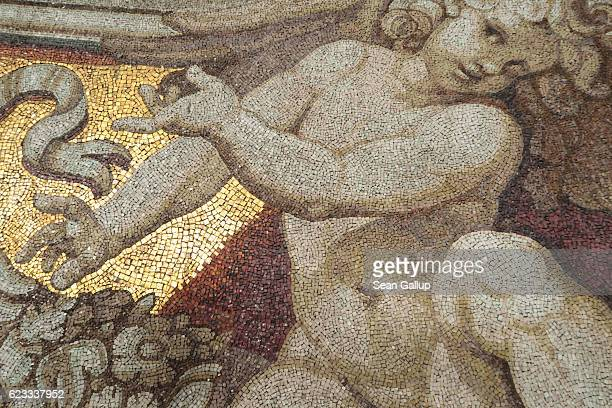 A mosaic of a cherub adorns an upper portion of St Peter's Basilica in Vatican City on October 27 2016 in Rome Italy Rome is among Europe's major...
