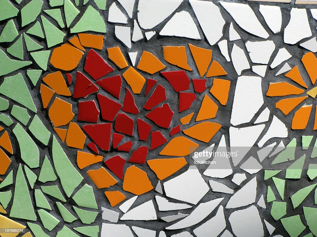 Mosaic of a red and orange heart on green and white tile : Stock Photo