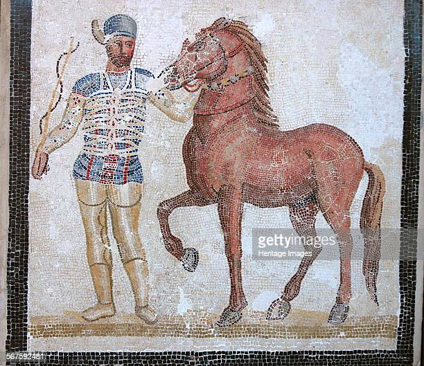 Mosaic of roman charioteer and horse of the Blue Team of the Circus Maximus Culture Roman Period/ Date 3rd C AD Place of Origin Villa at Baccano Rome...