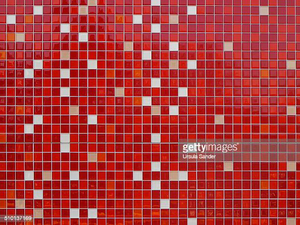 Mosaic of square tiles in red and white