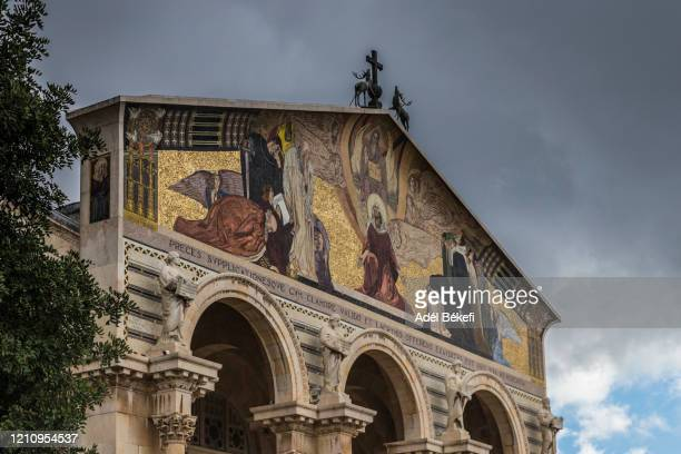 mosaic on the facade of the church of all nations (basilica of the agony) - garden of gethsemane stock pictures, royalty-free photos & images