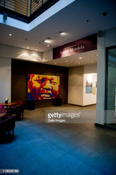 A mosaic portrait of former South African President Nelson Mandela made entirely out of Rubik's Cubes by Jan Du Plessis stands at the entrance of...