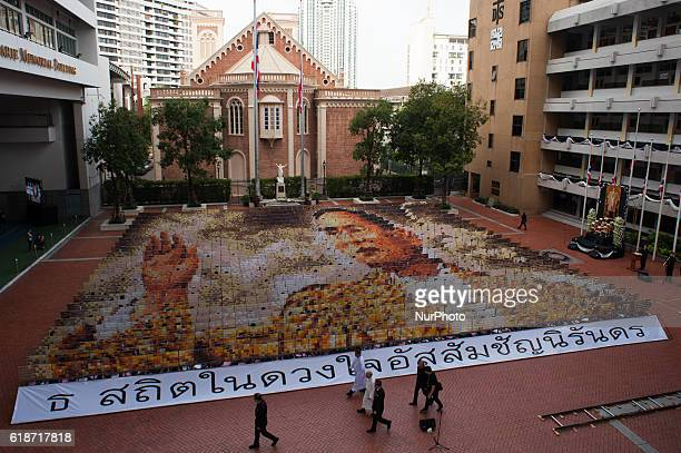 Mosaic portrait of the late Thai King Bhumibol Adulyadej is displayed as the 1,250 students practice flipping boards, at Assumption College in...