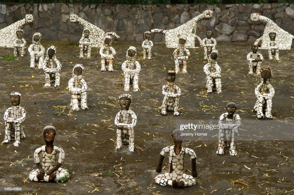 Mosaic statues in Nek Chand`s Rock Garden