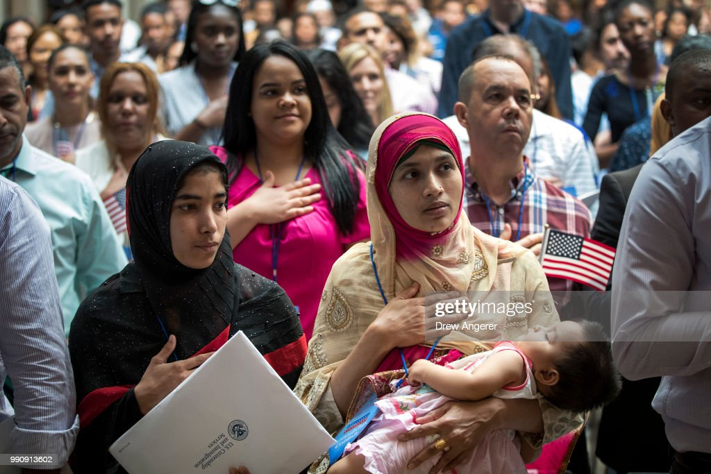Immigrants From Over 50 Countries Become U.S. Citizens At The New York Public Library : News Photo
