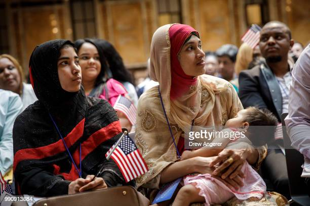 Mosammat Rasheda Akter originally from Bangladesh holds her 7 monthold daughter Fahmida as she waits to officially become a US Citizen during a...