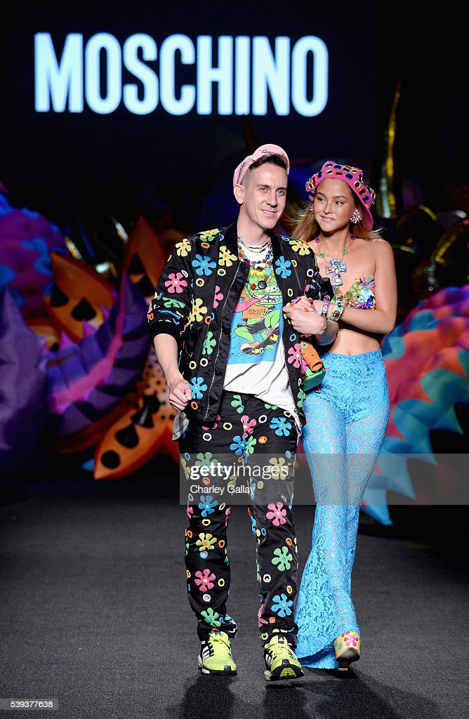 Moschino Creative Director Jeremy Scott (L) and model Model Devon Aoki walk the runway at the Moschino Spring/Summer 17 Menswear and Women's Resort Collection during MADE LA at L.A. LIVE Event Deck on June 10, 2016 in Los Angeles, California.