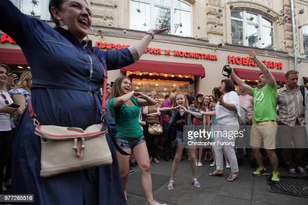 Moscovites dance in the street as they enjoy the World Cup party atmosphere on Nikolskaya Street near Red Square on June 17 2018 in Moscow Russia...