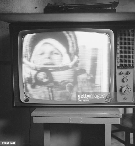 'Cosmonette' Valentina Tereshkova smiles broadly from outer space in this picture taken off a television screen here after she fired into orbit The...