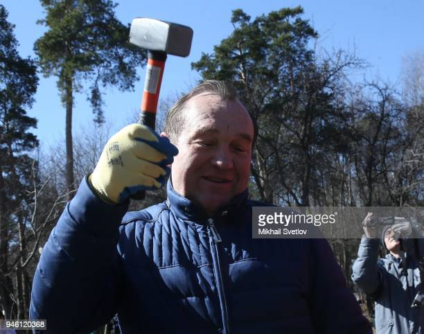 Moscow Deputy Mayor Pyotr Biryukov holds a hammer during the subbotnik at Sosenki park in Moscow Russia April 2018 Moscow government called Muscovits...