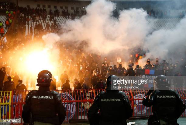 Moscow fans light flares during UEFA Europa League Round of 32 match between Crvena Zvezda Belgrade and CSKA Moscow at the Rajko Mitic Stadium on...