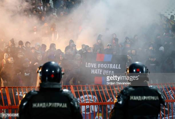 Moscow fans light torches during UEFA Europa League Round of 32 match between Crvena Zvezda Belgrade and CSKA Moscow at the Rajko Mitic Stadium on...