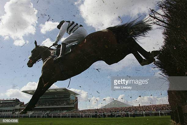 Moscow Flyer ridden by Barry Geraghty during their win in the John Smith's Melling Steeple Chase race at Aintree Racecourse on April 8 2005 in...