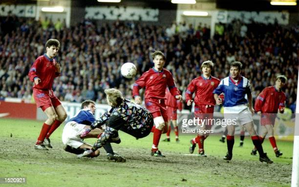 Moscow goalkeeper Plonitkov saves from Ian Durrant of Rangers during a Champions League match at Ibrox Stadium in Glasgow, Scotland. \ Mandatory...
