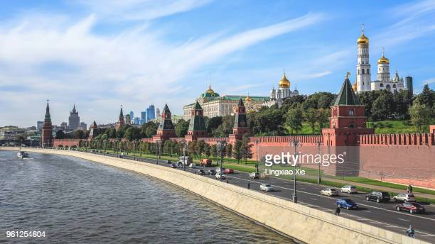 Moscow Kremlin along Moscow River with city highway at noon, Russia