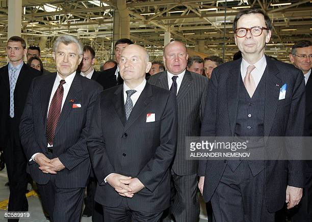 Moscow Mayor Yuri Luzhkov and Renault company chairman Louis Schweitzer and other officials walk at the Avtoframos automobile plant in Moscow 05...