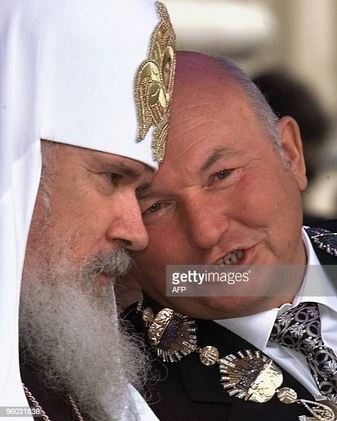 Moscow Mayor Yuri Luzhkov talks with AllRussia Patriarch Alexiy II during the opening ceremony of annual Day of the City in Moscow 04 September 1999...