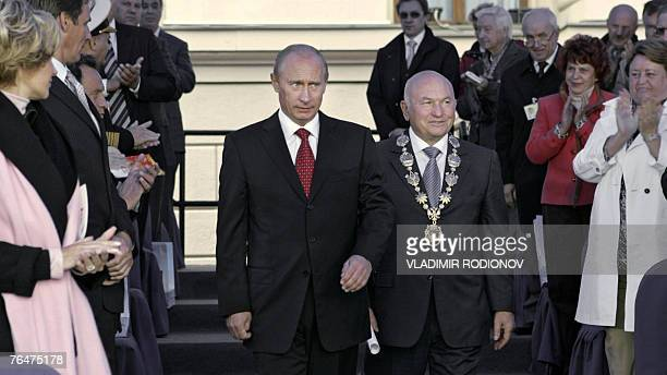Moscow Mayour Yuri Luzhkov and Russian President Vladimir Putin accept applause during celebrations marking Moscow's 860th anniversary in central...