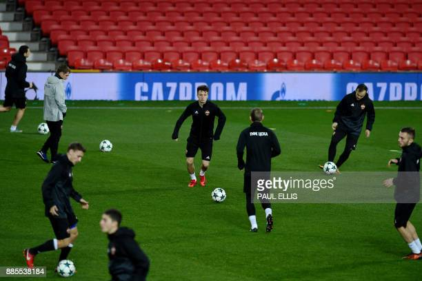 Moscow midfielder Aleksandr Golovin and teammates attend a training session at Old Trafford in Manchester northwest England on December 4 on the eve...