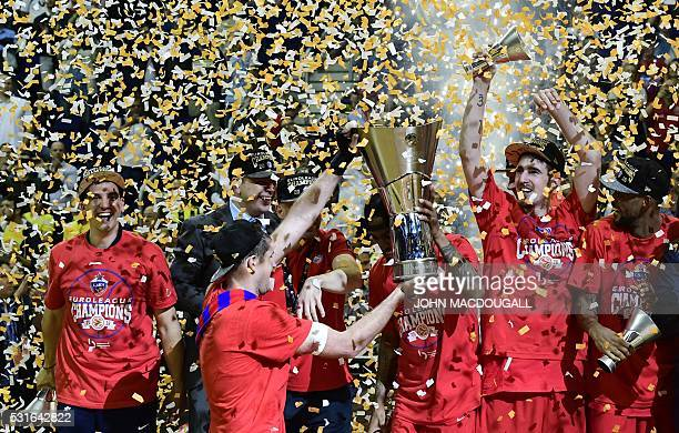 Moscow players celebrate after winning the final at the Euroleague Final Four in Berlin on May 15 2016 CSKA Moscow defeated Fenerbahce Istanbul 101...