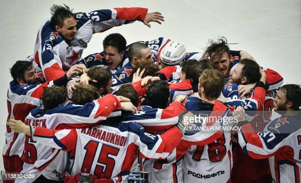 Moscow players celebrate their victory over Avangard Omsk after the Gagarin Cup 2019 final series game of the Russian Kontinental Hockey League...