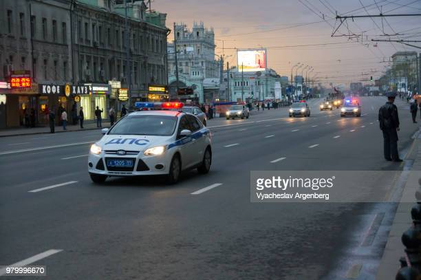 moscow police car on tverskaya street, sunset time, russia - argenberg stock pictures, royalty-free photos & images