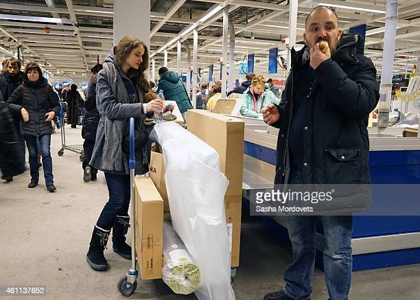 Moscow residents buy items at an IKEA store on January 7 2015 in Moscow Russia In anticipation of rising prices many shops in Russia observed...