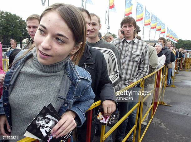 A girl holding tickets for the concert of US pop star Madonna waits in line in Moscow 06 September 2006 to exchange them bacause of a change of the...