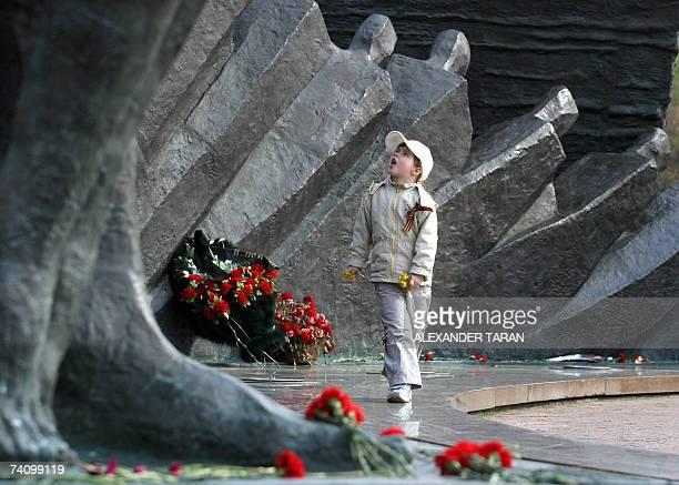 A girl walks at a memorial to WW II at Poklonnaya hill in Moscow 08 May 2007 Russia celebrates Victory Day over Nazis in World War II this Wednesday...