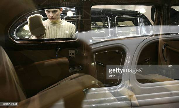 A man as he cleanes a window of ZIS110 limousine used by Josef Stalin from a special purpose garage of FSB before the opening of retro cars...