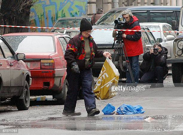 A municipal worker cleans the place where a student from Senegal was killed in SaintPetersburg 07 April 2006 A student from Senegal was shot dead...