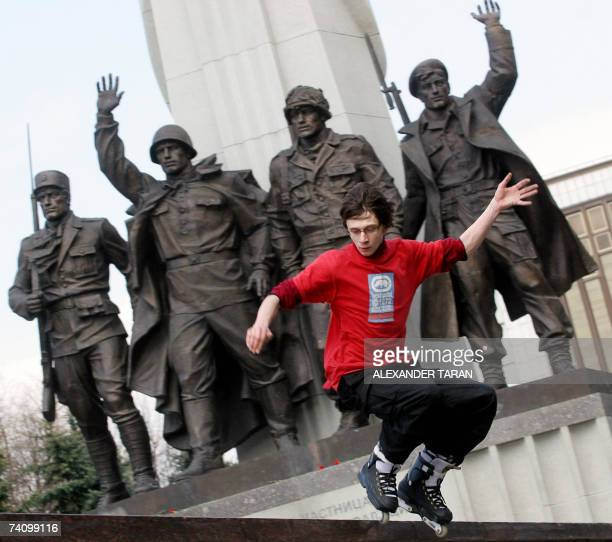 A roller skater jumps near a memorial of WW II at Poklonnaya hill in Moscow 08 May 2007 Russia celebrates the Victory Day over Nazis in World War II...