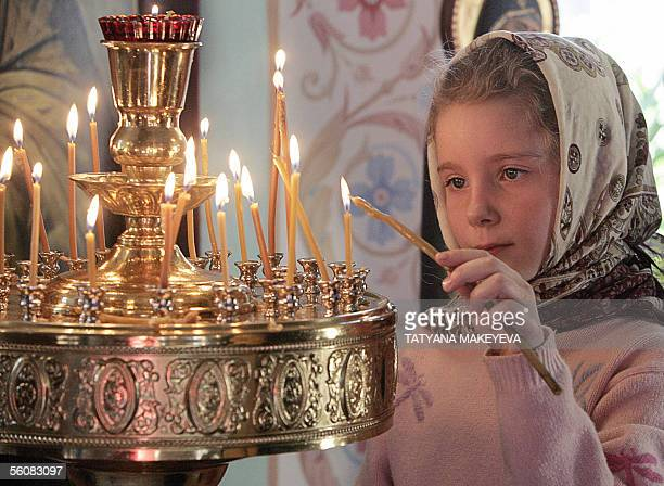 A Russian girl lights up a candle at a church marking the new state National Unity Day holiday instituted in honour of Moscow's liberation from...