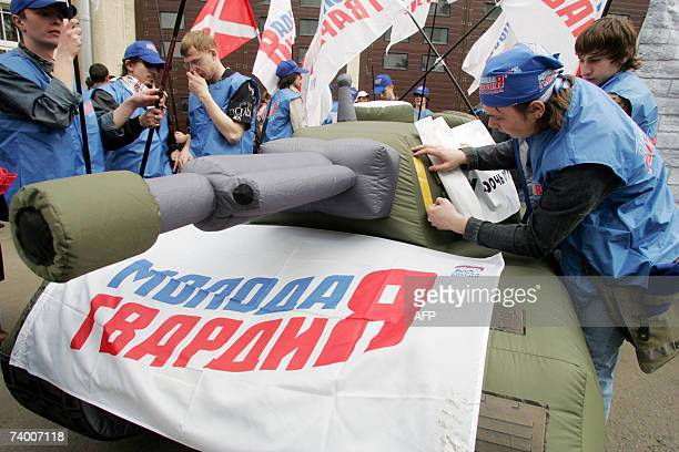 Activists of Young Guards of United Russia movement set up an inflatable rubber tank model during a rally in front of the Estonian embassy in Moscow...