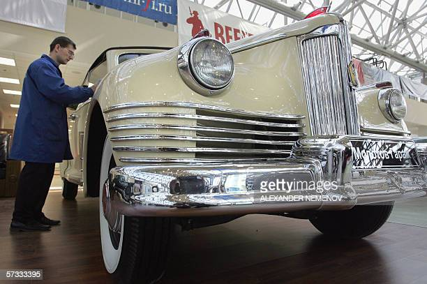 An exhibition staffer prepares a Stalin era governmental ZIS110 vehicle prior tothe Super Car Bike auction orginized by Sothbey's in Moscow 13 April...